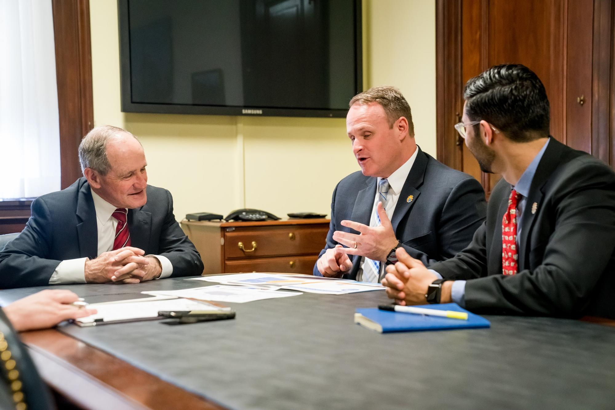 Dr. Adam Hodges speaking with United States Senator Jim Risch in 2019.